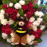 funeral_flowers_carnations_bear